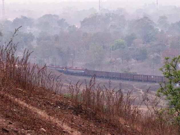 Train vanishing round the bend