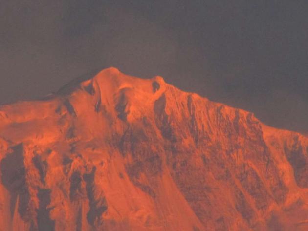 Golden glow on snow peak