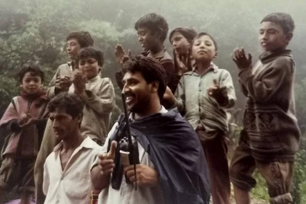 Radio officer dancing with village boys